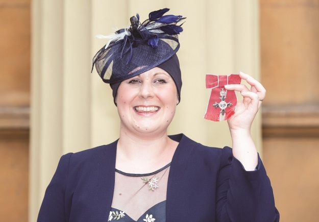 Kate Granger holds her MBE which was awarded to her by the Prince of Wales at an investiture ceremony at Buckingham Palace, London.